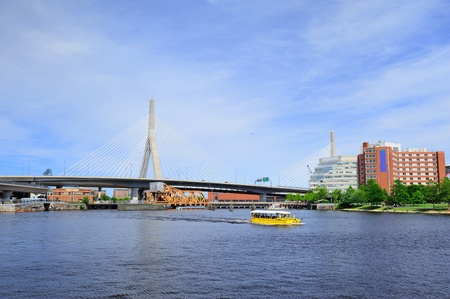 Boston Leonard P. Zakim Bunker Hill Memorial Bridge with blue sky as the famous land mark over Charles River. photo