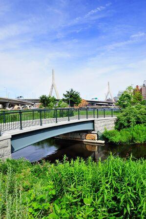 Boston Leonard P. Zakim Bunker Hill Memorial Bridge with blue sky in park as the famous land mark. photo
