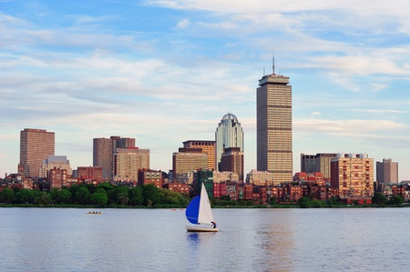 prudential: Boston city skyline with Prudential Tower and urban skyscrapers over Charles River with boat.