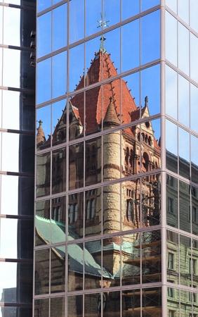 hancock building: Trinity Church reflection on Hancock Building in Boston street.
