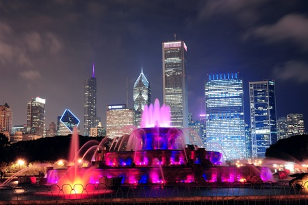 chicago skyline: Chicago skyline with skyscrapers and Buckingham fountain in Grant Park at night lit by colorful lights. Editorial