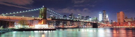 New York City Brooklyn Bridge panorama with downtown skyline over East River.