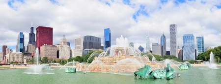 Chicago skyline panorama with skyscrapers and Buckingham fountain in Grant Park in the morning.