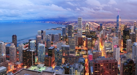 Chicago skyline panorama aerial view with skyscrapers over Lake Michigan with cloudy  sky at dusk. photo