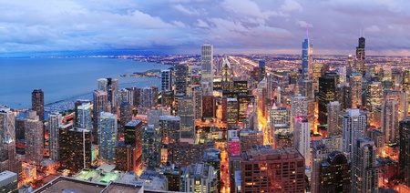 Chicago skyline panorama aerial view with skyscrapers over Lake Michigan with cloudy  sky at dusk. Editorial