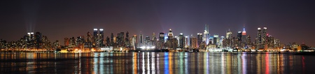 new york at night: New York City Manhattan midtown skyline at night with lights reflection over Hudson River viewed from New Jersey Weehawken waterfront. Stock Photo