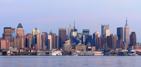New York City Manhattan sunset panorama with historical skyscrapers over Hudson River viewed from New Jersey Weehawken waterfront at dusk with tranquil blue tone. Stock Photo - 12575022