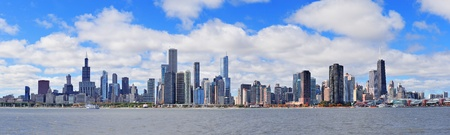chicago skyline: Chicago city urban skyline panorama with skyscrapers over Lake Michigan with cloudy blue sky. Stock Photo