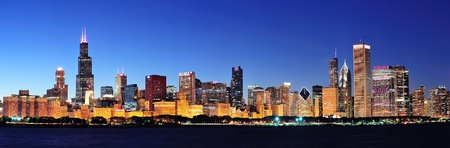 chicago skyline: Chicago city downtown urban skyline panorama at dusk with skyscrapers over Lake Michigan with clear blue sky.