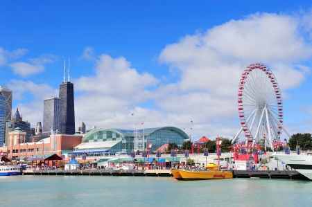 CHICAGO, IL - Oct 1: Navy Pier and skyline on October 1, 2011 in Chicago, Illinois. It was built in 1916 as 3300 foot pier for tour and excursion boats and is Chicago's number one tourist attraction. Stock Photo - 12559694