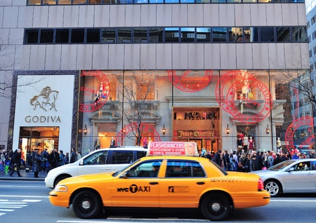 NEW YORK CITY, NY - DEC 30: Busy traffic on street on December 30, 2011 in New York City. Fifth Avenue has the worlds most expensive retail spaces as the symbol of wealthy New York.