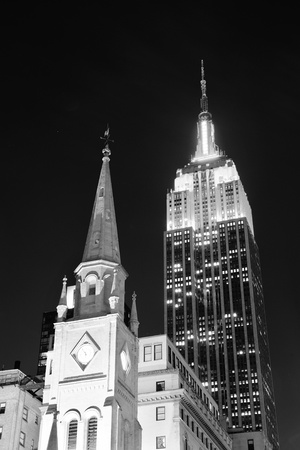 NEW YORK CITY, NY - DEC 30: Empire State Building and church on December 30, 2011 in New York City. It is a 102-story landmark and was worlds tallest building for more than 40 years.