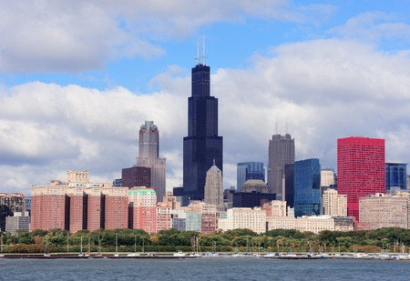 Chicago skyline panorama with skyscrapers over Lake Michigan with cloudy blue sky. Stock Photo - 12574275