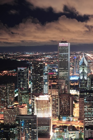 Chicago urban skyline panorama aerial view with skyscrapers and cloudy sky at dusk with lights. Stock Photo - 12571350