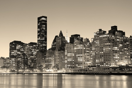 east river: New York City Manhattan midtown skyline black and white at night over East River. Stock Photo