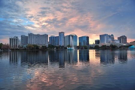 Orlando Lake Eola sunset with urban architecture skyline and colorful cloud photo
