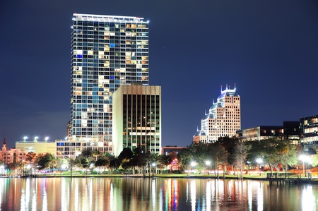 Urban architecture with Orlando downtown skyline over Lake Eola at dusk  photo