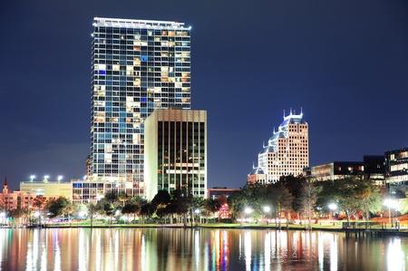 orlando: Urban architecture with Orlando downtown skyline over Lake Eola at dusk