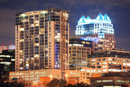 Urban architecture with Orlando downtown skyline over Lake Eola at dusk
