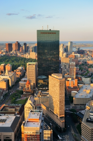 boston cityscape: Urban city aerial view. Boston aerial view with skyscrapers at sunset with city downtown skyline.