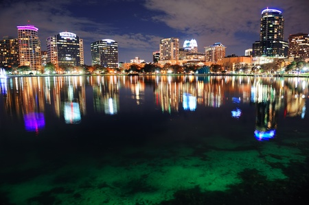 Orlando downtown skyline over Lake Eola at dusk with urban skyscrapers and lights. Stock Photo - 12574279
