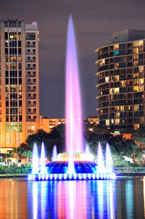 Fountain closeup with Orlando downtown skyline over Lake Eola at dusk with urban skyscrapers and lights. Stock Photo - 12571355