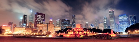 Chicago skyline panorama with skyscrapers and Buckingham fountain in Grant Park at night lit by colorful lights  photo