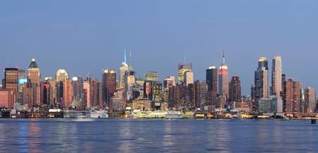Hudson River waterfront view of New York City Manhattan after sunset with cityscape panorama and light reflection in tranquil blue tone  Stock Photo