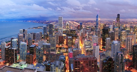 Chicago skyline panorama aerial view with skyscrapers over Lake Michigan with cloudy  sky at dusk  Stock Photo