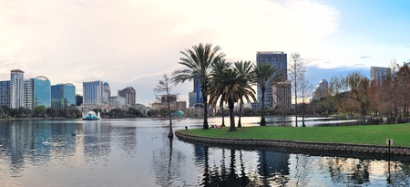 orlando: Orlando downtown Lake Eola panorama with urban buildings and reflection Stock Photo