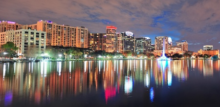 Orlando Lake Eola panorama with office buildings at night Editorial