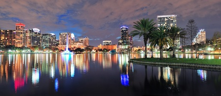 Orlando Lake Eola panorama with office buildings at night Stock Photo