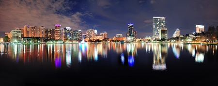 orlando: Orlando Lake Eola panorama with office buildings at night Editorial
