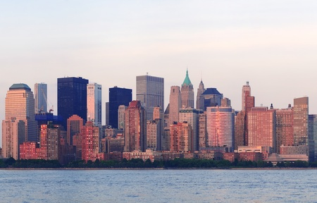 New York City Manhattan downtown skyline at sunset over Hudson River panorama photo