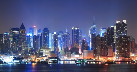 hudson: New York City Manhattan midtown skyline at night with skyscrapers lit over Hudson River with reflections