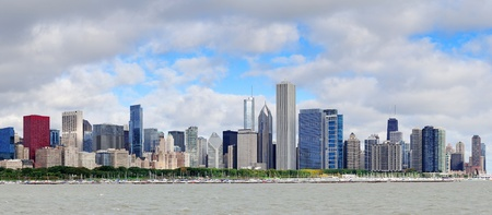 Chicago skyline panorama with skyscrapers over Lake Michigan with cloudy blue sky  photo