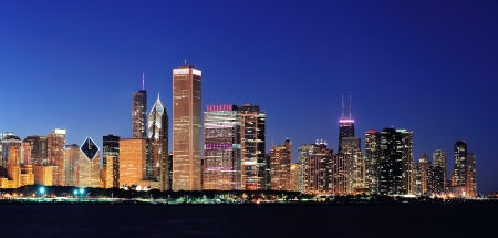 night dusk: Chicago city downtown urban skyline panorama at dusk with skyscrapers over Lake Michigan with clear blue sky