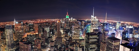New York City skyline aerial panorama view at night with Empire State Building, Times Square and skyscrapers of midtown Manhattan