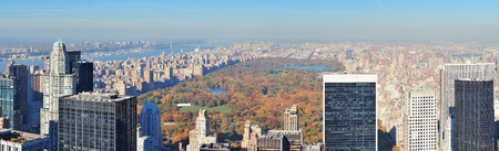 New York City skyscrapers in midtown Manhattan aerial panorama view in the day with Central Park and colorful foliage in Autumn  photo