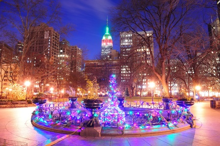 New York City Madison Square park view with Christmas color lights and Manhattan skyscrapers. Editorial
