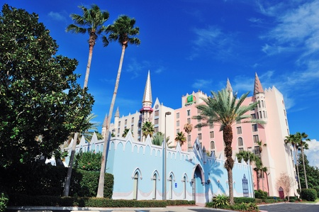 ORLANDO, FL - FEB 6: Holiday Inn building with blue sky on February 6, 2012 in Orlando, Florida. It is one of the world's largest hotel chains with 238,440 bedrooms and 1,301 hotels globally. Stock Photo - 13021706
