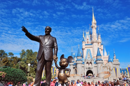 ORLANDO, FL - FEB 13: Castle and Walt Disney statue on February 13, 2012 in Orlando, Florida. Magic Kingdom is the most visited theme park in the world attracting 17 million visitors in 2010.