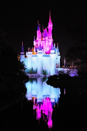 ORLANDO, FL - FEB 13: Cinderella Castle in colors on February 13, 2012 in Orlando, Florida. Magic Kingdom is the most visited theme park in the world attracting 17 million visitors in 2010.