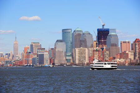Urban skyscrapers and boat from New York City Manhattan downtown over river. Stock Photo - 12993128