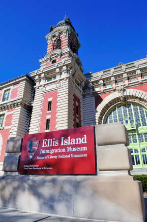 great hall: New York City Ellis Island Great Hall with blue clear sky