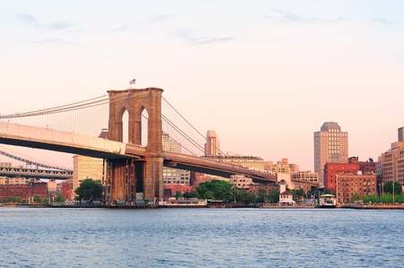 Brooklyn Bridge over East River viewed from New York City Lower Manhattan waterfront at sunset. Stock Photo - 12993225