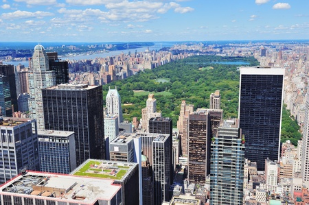 central park: New York City Manhattan midtown aerial panorama view with skyscrapers and central park in the day.