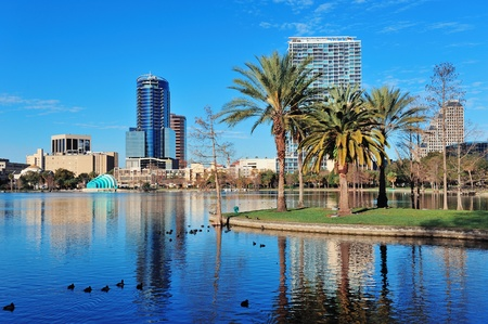 Orlando Lake Eola in the morning with urban skyscrapers and clear blue sky. Stock fotó - 12993138