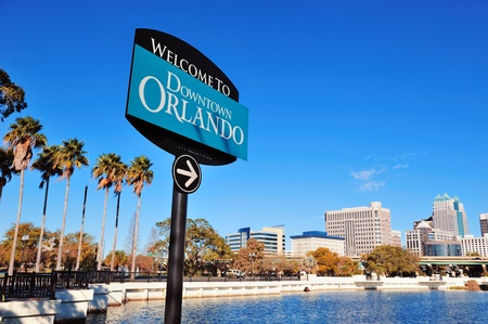 florida: Orlando downtown welcome sign with tropical scene Editorial
