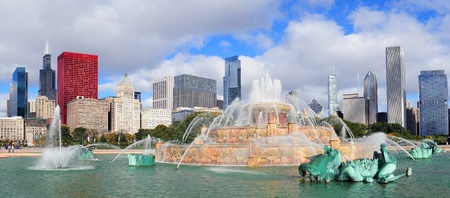Chicago skyline panorama with skyscrapers and Buckingham fountain in Grant Park in the morning with cloud and blue sky